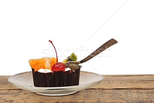 Chocolate cupcake with a cherry and tropical fruit on glass dish Stock photo © inxti
