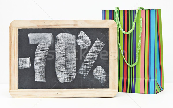 seventy percent discount written on blackboard with colorful sho Stock photo © inxti