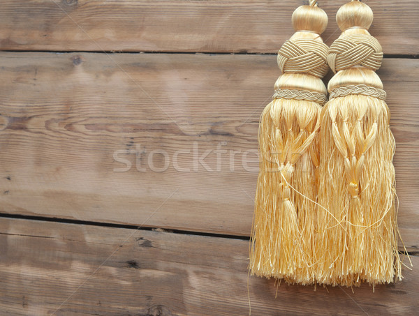 Gold curtain tassel against wooden wall Stock photo © inxti