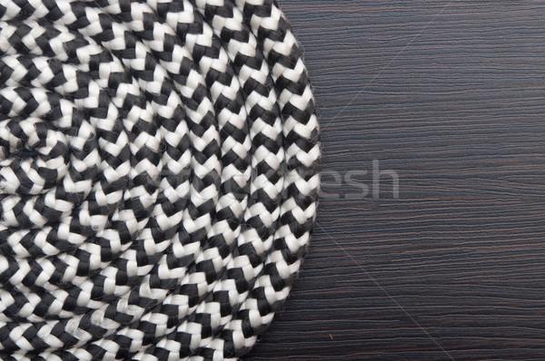 Roll of marine rope on dark wooden background  Stock photo © inxti