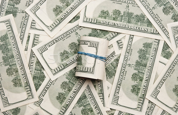 Background with money american hundred dollar bills and roll of  Stock photo © inxti