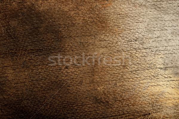 burned burlap on wood background  Stock photo © inxti