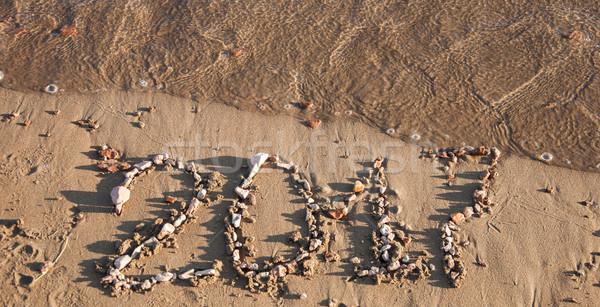 Calendar on sand. Year 2017 Stock photo © inxti