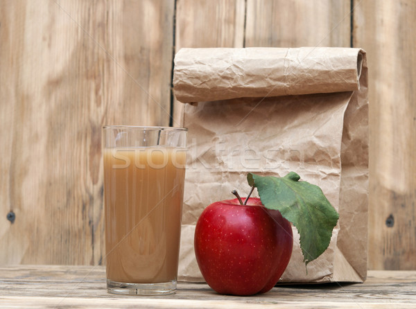 apple with apple juice and paper bag on a wooden background Stock photo © inxti