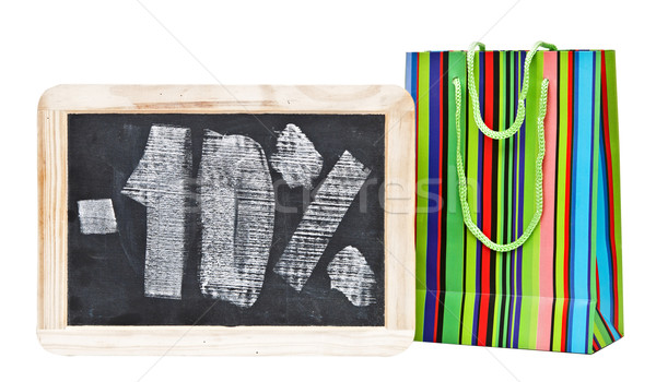 Stock photo: Ten percent written on blackboard with colorful shopping bag