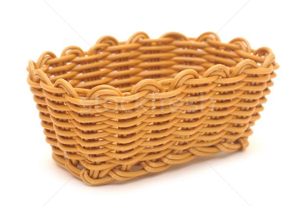 Empty wicker basket. Isolated over white Stock photo © inxti