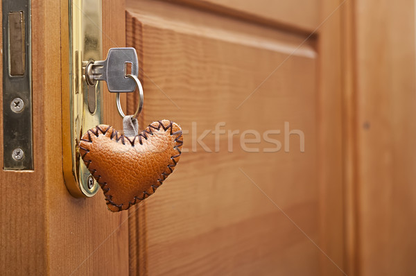 Key with leather trinket in keyhole Stock photo © inxti