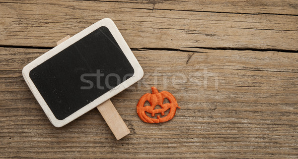 Halloween pumpkin over chalkboard. Stock photo © inxti