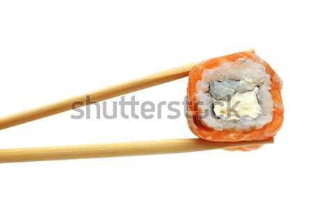 Sushi with chopsticks  Stock photo © inxti