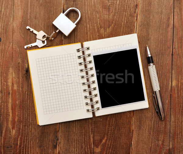 notebook with old photo and lock and key  Stock photo © inxti