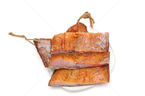 pieces smoked fish on a white background Stock photo © inxti