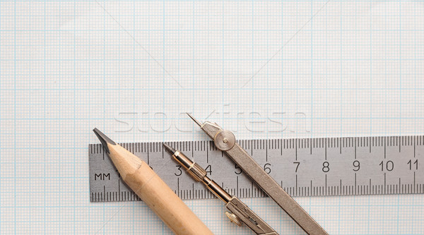 Still life photo of engineering graph paper with pencil, compass Stock photo © inxti