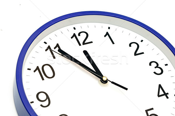 blue wall clock five minutes to twelve Stock photo © inxti