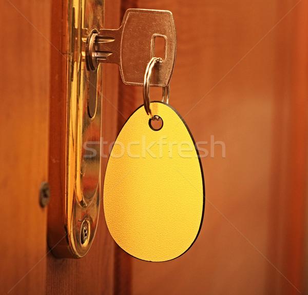 Clé serrure étiquette bureau maison design Photo stock © inxti