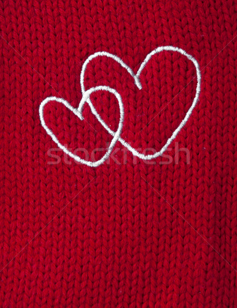 two white heart embroidered handmade on red canvas  Stock photo © inxti