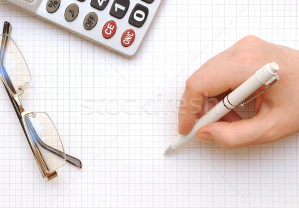 Close up of a calculator, eyeglass, organizer and pen  Stock photo © inxti