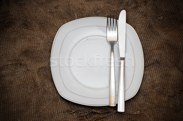 Plate fork and knife on brown sacking texture  Stock photo © inxti
