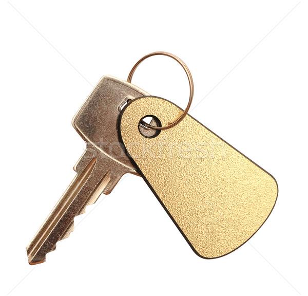 Anahtar altın etiket metin yalıtılmış beyaz Stok fotoğraf © inxti