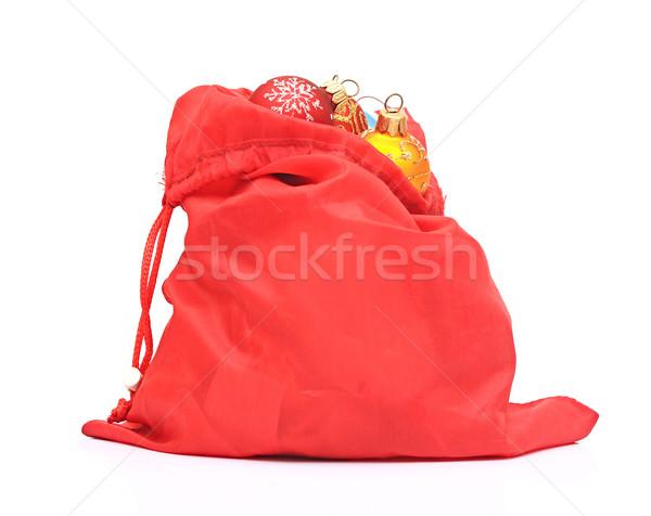 Santa Claus red bag with Christmas toys on white background. Stock photo © inxti