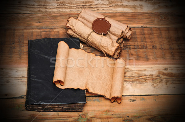 Scrolls of vintage paper with old book Stock photo © inxti