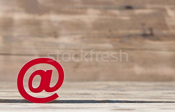 E-mail symbol on old wooden background  Stock photo © inxti