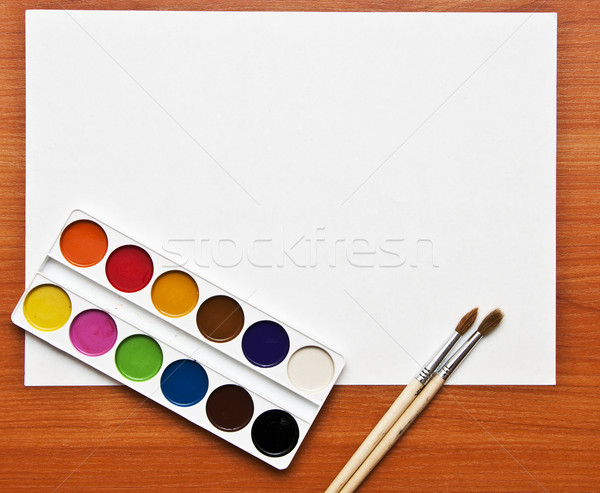 Watercolor paints set with brushes and paper sheet  Stock photo © inxti
