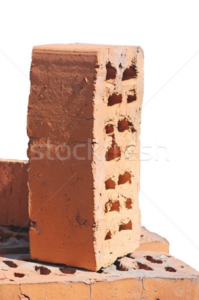 Stack of red bricks over white background  Stock photo © inxti