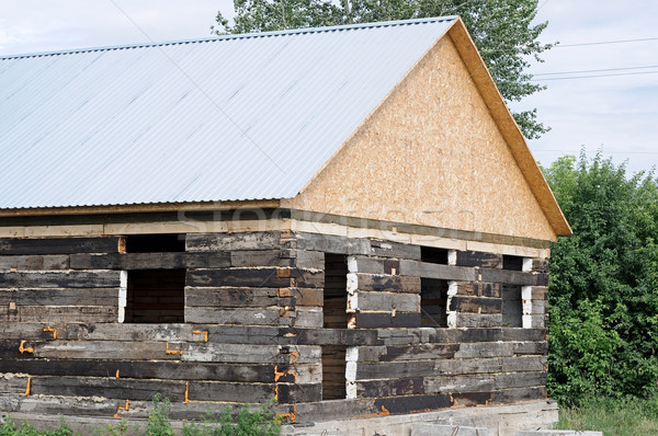 Unfinished wooden house and building area  Stock photo © inxti