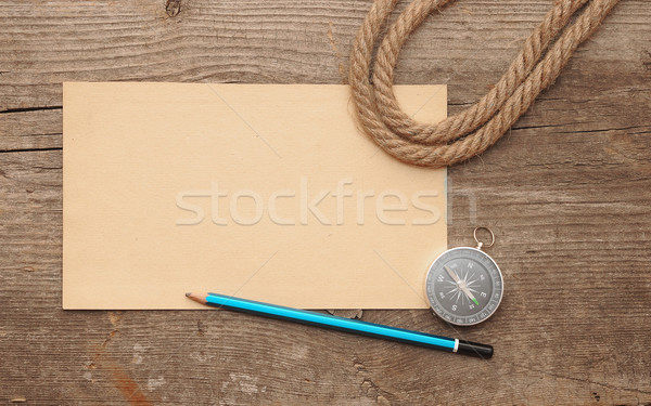 compass, old paper, pencil and rope on wooden backround Stock photo © inxti