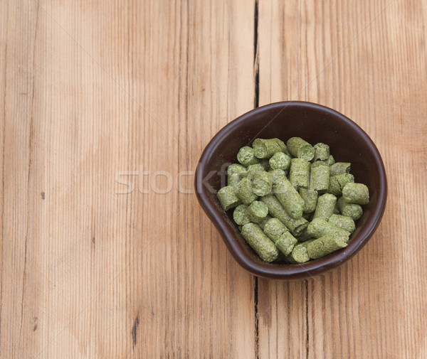 beer ingredients: toppellets of hops on wooden table Stock photo © inxti