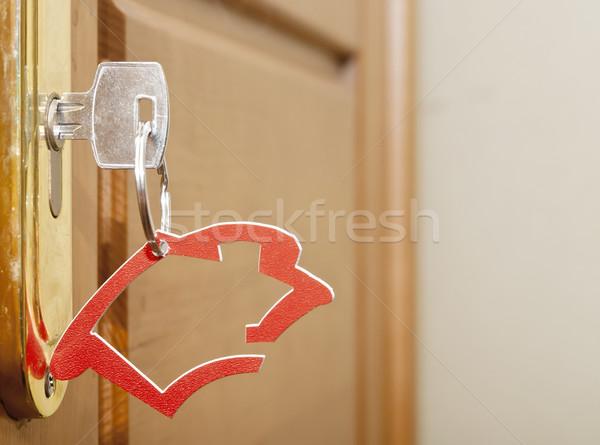 Symbole maison bâton clé serrure bois Photo stock © inxti