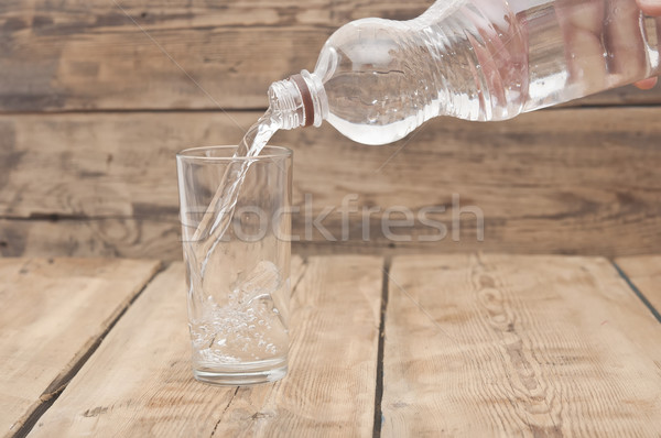 Stock photo: Water pour on to glass on wood table