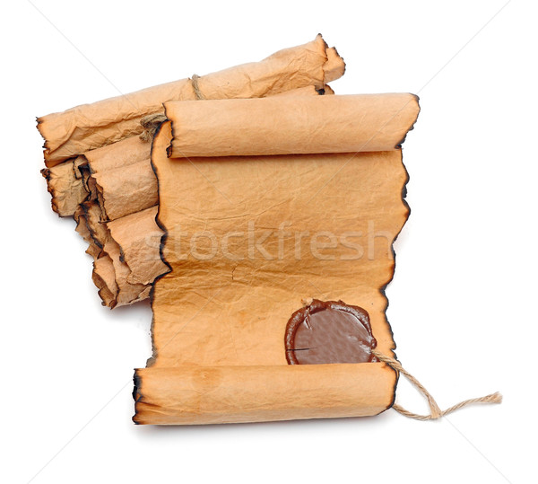 Scroll of vintage paper on white background  Stock photo © inxti