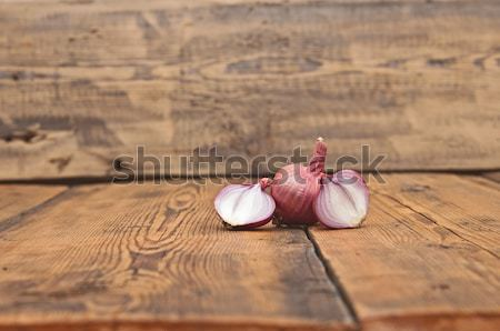Red sliced onion on old wooden table Stock photo © inxti
