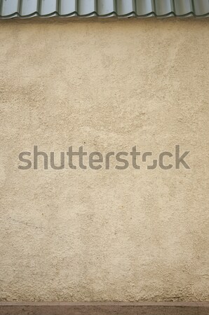 Old stone wall with metal roof tile Stock photo © inxti