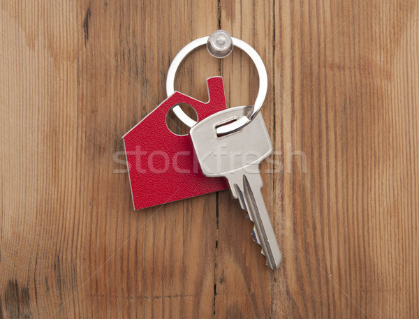 Symbol of the house with silver key on vintage wooden background Stock photo © inxti