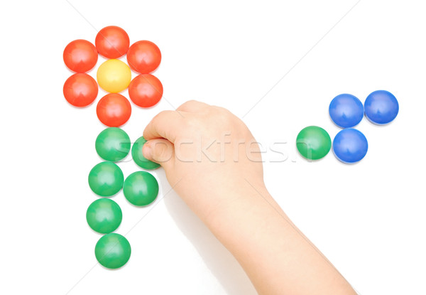 Stock photo: Hand and toy button on white background