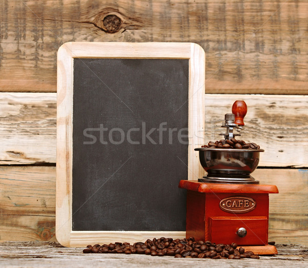 coffee mill and blank chalkboard over wooden background Stock photo © inxti