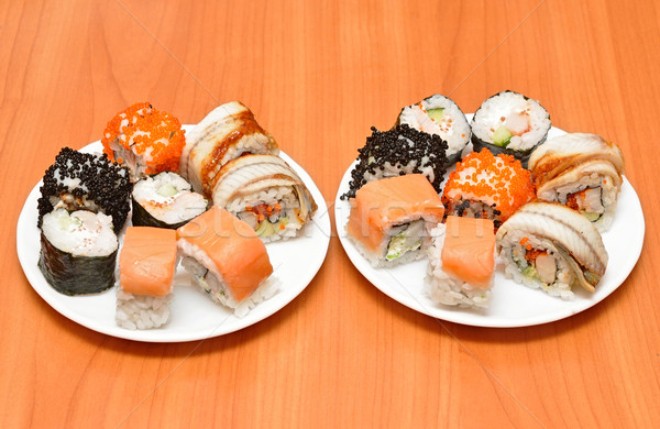Seafood. Traditional sushi and rolls on the dish Stock photo © inxti