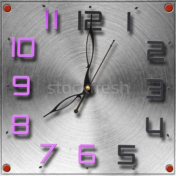 Modern clock on circular metal brushed texture  Stock photo © inxti