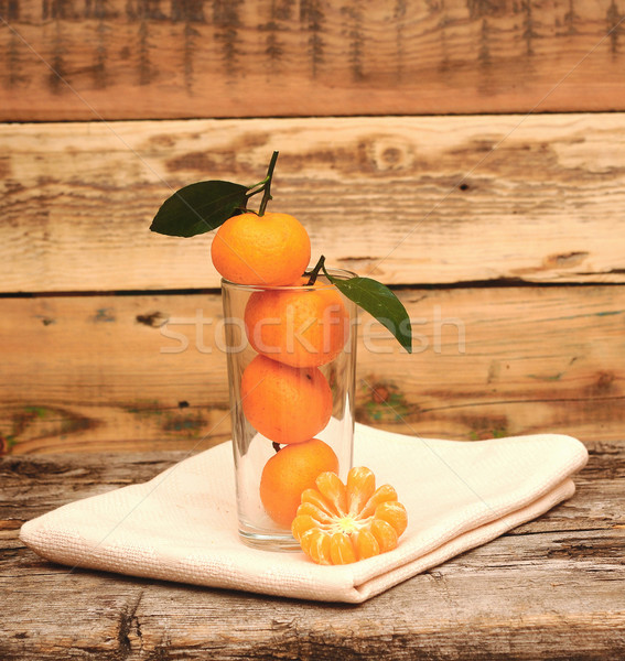 fresh tangerine and segments in a glass  Stock photo © inxti