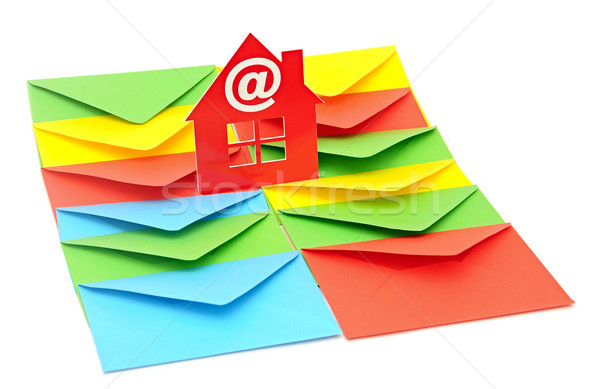 red plastic house shaped object on colorful envelopes white back Stock photo © inxti