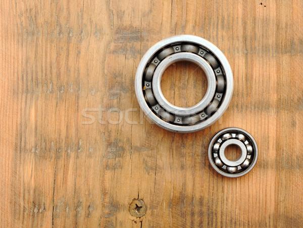 steel ball bearings on wooden background Stock photo © inxti