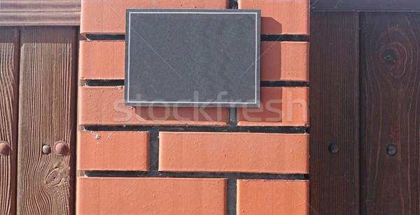 Marmo segnale stradale vecchio muro di mattoni città muro Foto d'archivio © inxti