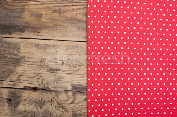 Empty wooden deck table with red tablecloth with polka dots Stock photo © inxti