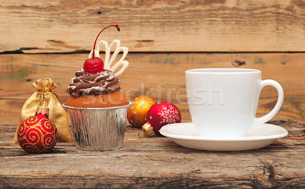 Chocolate cherry cupcakes on old wooden background. Christmas br Stock photo © inxti