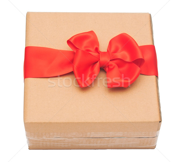 red ribbon bow on cardboard box. holidays background Stock photo © inxti