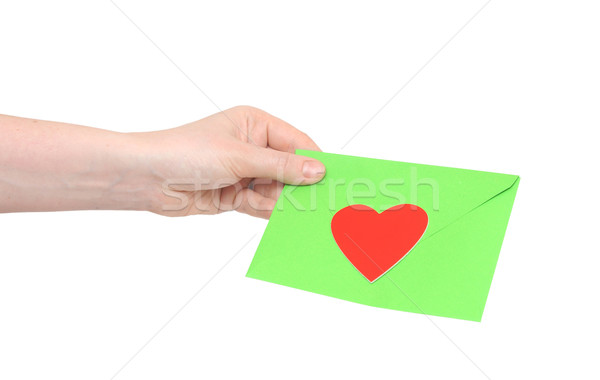 human hand and love letter on white background Stock photo © inxti