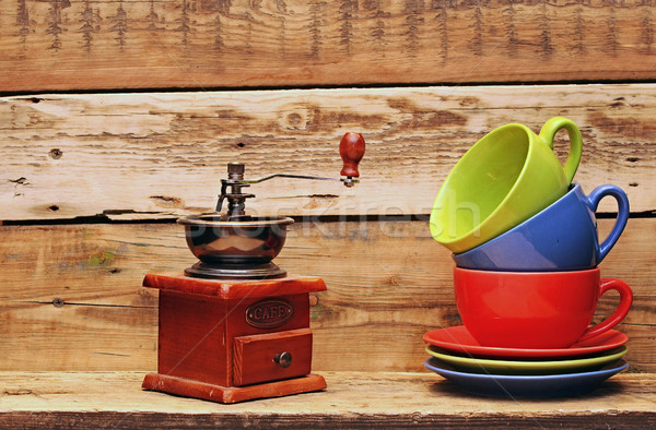 Colorful coffee mugs with coffee mill over an grunge wooden back Stock photo © inxti