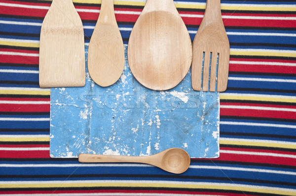 wooden utensils and old paper sheet on colorful tablecloth Stock photo © inxti